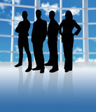 Silhouette Team. Business team in an office in silhouette royalty free illustration