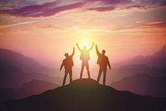 Silhouette of the team on the mountain royalty free stock photography