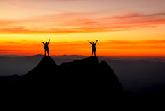 Silhouette of a team. success as concept. Sunset Royalty Free Stock Image
