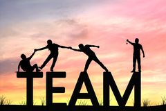 silhouette team work of men helping stock photography