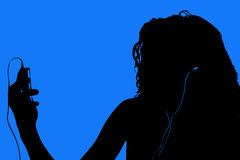 Silhouette of Teen with Digital Video Player Royalty Free Stock Image