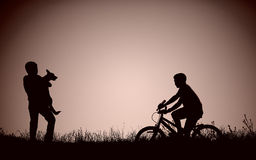 Silhouette of teenage boys on the field Stock Photography