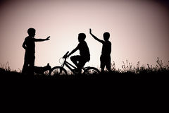 Silhouette of teenage boys friends Royalty Free Stock Image