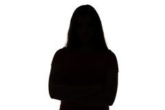 Silhouette of teenage girl with arms crossed. Photo of silhouette teenage girl with arms crossed on white background Royalty Free Stock Photos