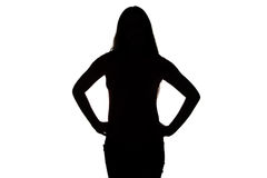 Silhouette of teenage girl with hands on hip Royalty Free Stock Photography