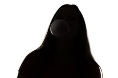 Silhouette of teenage girl inflating the bubble Stock Photography