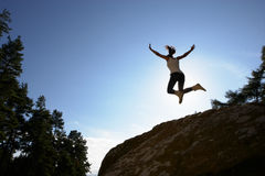 Silhouette Of Teenage Girl Leaping In Air Stock Photos