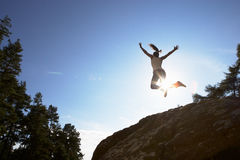 Silhouette Of Teenage Girl Leaping In Air Stock Images