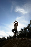 Silhouette Of Teenage Girl Meditating Outdoors Royalty Free Stock Photography