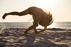 Silhouette of a teenage girl in motion. Sunset and silhouette of a teenage girl in motion Stock Photos
