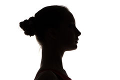 Silhouette of teenage girl's head Stock Images