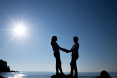 Silhouette of teenager couple on the beach. In Majorca Stock Image