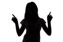 Silhouette of teenager girl with fingers up Royalty Free Stock Photo