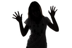 Silhouette of teenager girl with hands up Stock Photos