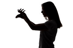 Silhouette of teenager girl making shadows play Royalty Free Stock Images