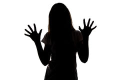 Silhouette of teenager girl with open hands Stock Image