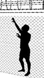 Silhouette of teenager trying to escape from wired enclosure. Silhouette of a teenager trying to escape from wired enclosure Stock Photos