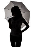 Silhouette of teenager with umbrella Stock Photo