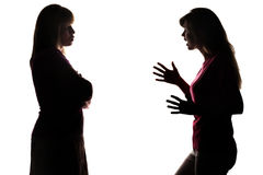 Silhouette teenager yelling at mom who silently listens. Silhouette on white isolated background conflict of parents and children, teenager yelling at mom who stock photo