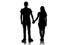 Silhouette of teenagers holding hands Royalty Free Stock Photography