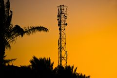 Silhouette of telecommunication antenna cellular tower for mobile signal network stock photo