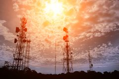Telecommunication mast television antennas. Silhouette of Telecommunication mast television antennas on sunset Stock Photo