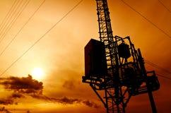 Silhouette telecommunication pole Stock Image