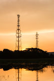 Silhouette telecommunications towers on sunrise Royalty Free Stock Photo