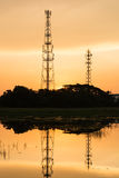 Silhouette telecommunications towers on sunrise Stock Photos