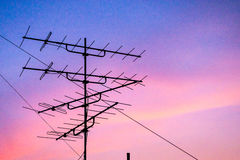 Silhouette television antenna on rooftop Stock Image