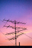 Silhouette television antenna on rooftop Stock Photos