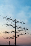 Silhouette television antenna on rooftop Royalty Free Stock Image