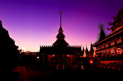 Silhouette of temple buddhism with evening light at chiangmai Royalty Free Stock Photography