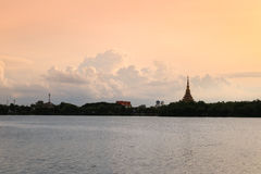 "Silhouette temple thai name ""Wat Nong Wang"" is located in Khonkaen,Thailand beautiful sky while sunset. Stock Images"