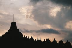 A silhouette temple under vanilla sky royalty free stock photography