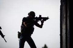 Silhouette of terrorist with assault rifle. At the day light Royalty Free Stock Photo