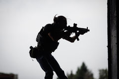 Silhouette of terrorist with assault rifle Royalty Free Stock Photo