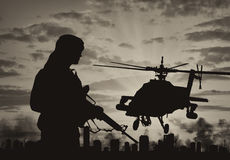 Silhouette of a terrorist and a helicopter Royalty Free Stock Photography