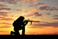 Silhouette of a terrorist with a rifle Stock Images