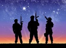 Silhouette terrorists against  sunrise Royalty Free Stock Photo