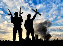 Silhouette of the terrorists and the city Royalty Free Stock Photography
