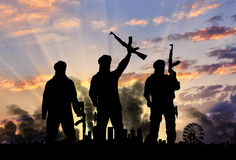 Silhouette of the terrorists and the city Royalty Free Stock Images