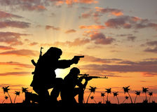 Silhouette of a terrorists Royalty Free Stock Photography
