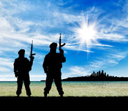 Silhouette of terrorists Stock Images