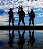 Silhouette of terrorists Stock Image