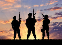 Silhouette of a terrorists Stock Photos