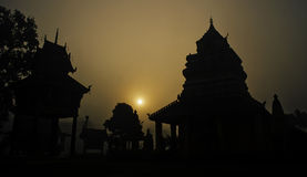 Silhouette of Thai Buddhist Pagoda in the Morning Sun Stock Photography