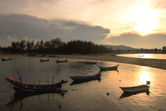 Silhouette of Thai fishing boats on sunset. Royalty Free Stock Photography