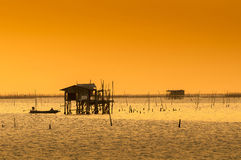Silhouette of thai fishing house Stock Photography