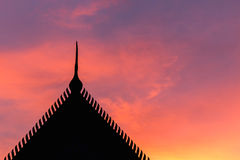 Silhouette Thai style temple roof and sunset Royalty Free Stock Photo